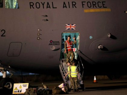 British Armed Forces personnel disembark a British Royal Air Force Boeing C-17A Globemaster III aircraft after landing at Brize Norton station, southern England, on August 29, 2021 after returning from deployment as part of Operation Pitting to evacuate British nationals and eligible personnel from Afghanistan. - The UK government on …