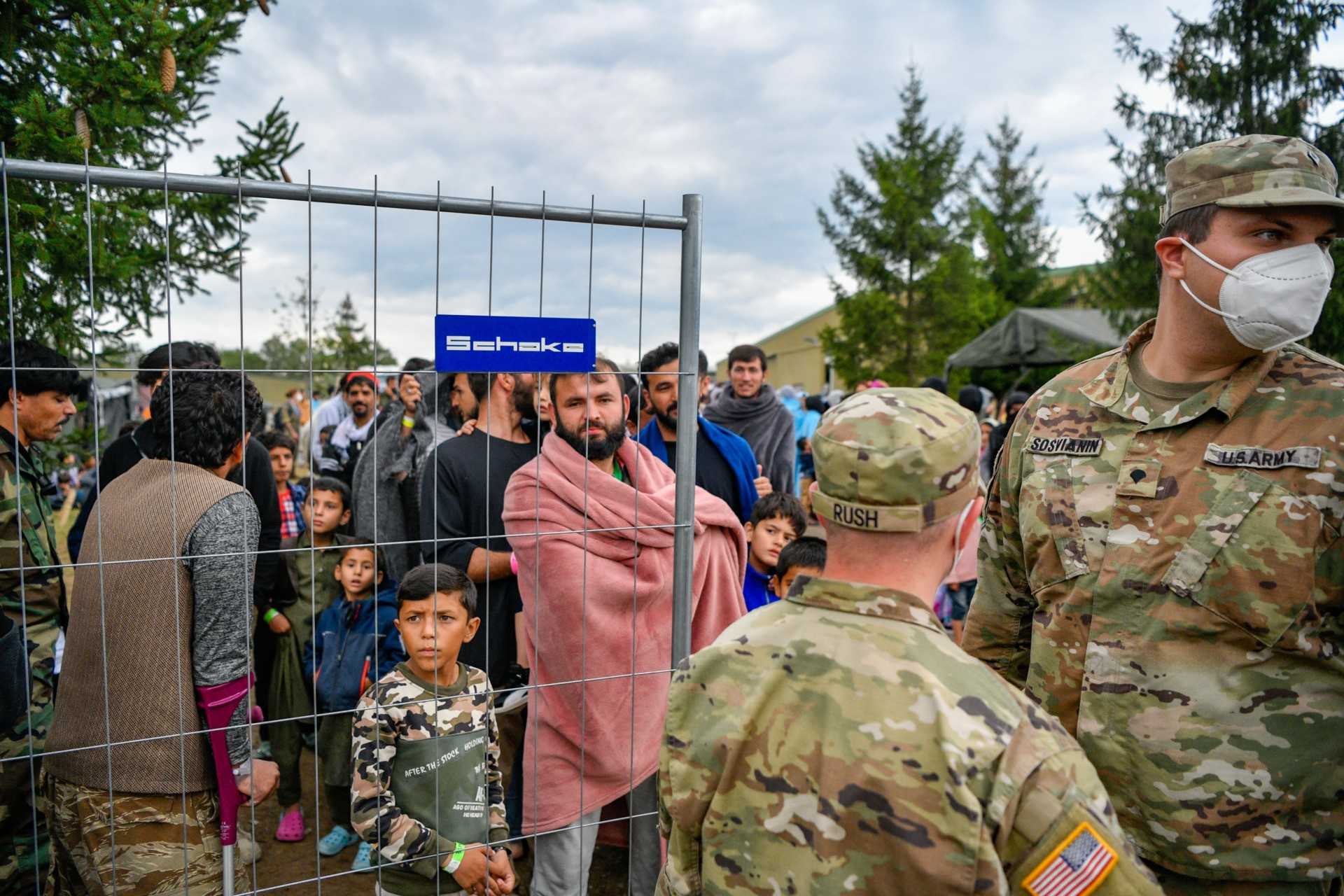 KAISERSLAUTERN, GERMANY - AUGUST 30: Recently-arrived refugees from Afghanistan seen at a temporary camp at the U.S. Army's Rhine Ordnance Barracks (ROB), where they are being temporarily housed, on August 30, 2021 in Kaiserslautern, Germany. Several U.S. military facilities with the capacity to house up to several thousand evacuees are participating, in an operation called Operation Allied Refuge. (Photo by Sascha Schuermann/Getty Images)