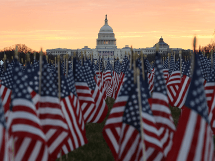 The U.S Capitol Building is prepared for the inaugural ceremonies for President-elect Joe Biden as American flags are placed in the ground on the National Mall on January 18, 2021 in Washington, DC. The approximately 191,500 U.S. flags will cover part of the National Mall and will represent the American …