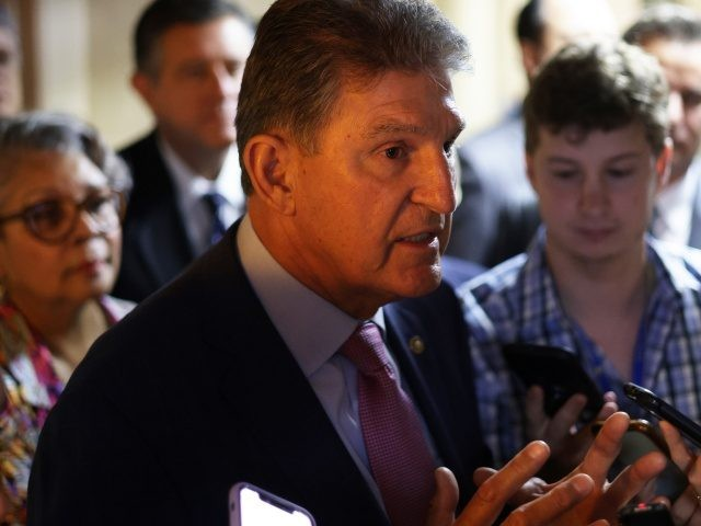 WASHINGTON, DC - JULY 15: U.S. Sen. Joe Manchin (D-WV) (C) talks to reporters as he leaves after a meeting with members of Texas House Democratic Caucus at the U.S. Capitol July 15, 2021 in Washington, DC. Members of Texas House Democratic Caucus continued their efforts to meet with U.S. …