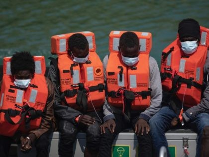 DOVER, ENGLAND - JULY 21: Migrant men arrive at Dover Port after being picked up in the English Channel by the Border Force on July 21, 2021 in Dover, England. On Monday, 430 migrants crossed the channel from France, a record for a single day. To stem the rising numbers, …