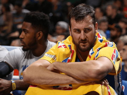 DENVER, CO - NOVEMBER 22: Andrew Bogut #12 of the Golden State Warriors looks on from the bench against the Denver Nuggets at Pepsi Center on November 22, 2015 in Denver, Colorado. The Warriors defeated the Nuggets 118-105 to start the season 15-0. NOTE TO USER: User expressly acknowledges and …