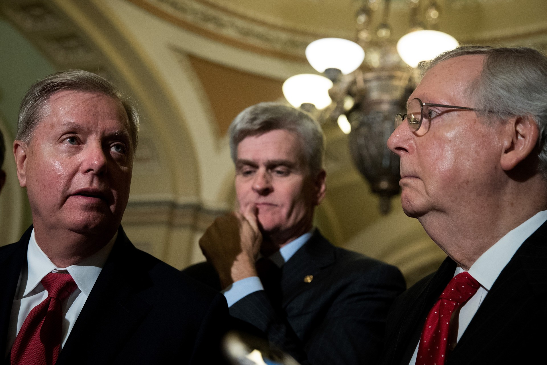 WASHINGTON, DC - SEPTEMBER 26: (L to R) Lindsey Graham (R-SC), Bill Cassidy (R-LA) and Majority Leader Mitch McConnell (R-KY) take questions from reporters during a news conference following their weekly policy luncheon, September 26, 2017 in Washington, DC. Leader McConnell announced they will not vote on the Graham-Cassidy health care bill, the GOP