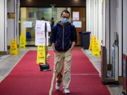 """This picture taken on February 13, 2020 shows doctor Alfred Wong walking out from a Hong Kong hospital following an interview with AFP in Hong Kong. - The 38-year-old volunteered to join staff on isolation wards -- dubbed """"the dirty team"""" -- to avoid the risk of being called up …"""