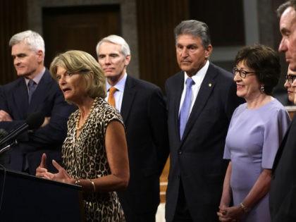 WASHINGTON, DC - JULY 28: U.S. Sen. Lisa Murkowski (R-AK) (2nd L) speaks as (L-R) Sen. Bill Cassidy (R-LA), Sen. Rob Portman (R-OH), Sen. Joe Manchin (D-WV), Sen. Susan Collins (R-ME), Sen. Kyrsten Sinema (D-AZ), Sen. Jeanne Shaheen (D-NH), Sen. Mark Warner (D-VA) and Sen. Mitt Romney (R-UT) listen during …