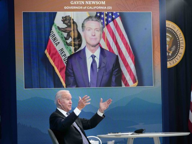 US President Joe Biden speaks as California Governor Gavin Newsom. on a screen, looks on during a meeting with state governors on wildfire prevention and preparedness in the South Court Auditorium of the Eisenhower Executive Office Building, next to the White House, in Washington, DC on July 30, 2021. (Photo …