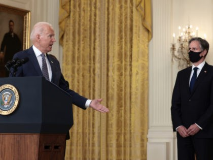 U.S. President Joe Biden gestures to Secretary of State Antony Blinken as he gives remarks on the U.S. military's ongoing evacuation efforts in Afghanistan from the East Room of the White House on August 20, 2021 in Washington, DC. The White House announced earlier that the U.S. has evacuated almost …