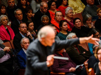 Audience members watch as Italian conductor Gianandrea Noseda conducts the National Symphony Orchestra (NSO) during a concert at the John F. Kennedy Center for the Performing Arts in Washington DC, on February 14, 2019. - In the concert hall, the sound is crisp, slicing through the air like a sharp …