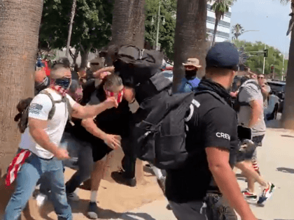 Twitter and anti-vaccine-mandate protester's brawl in downtown Los Angeles on August 14. (Twitter Video Screenshot/Sean Carmitchel)