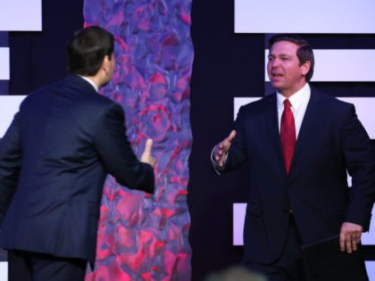DORAL, FLORIDA - FEBRUARY 01: Florida Gov. Ron DeSantis prepares to shake hands with Sen. Marco Rubio (R-FL) as he prepares to speak before Vice President Mike Pence takes to the stage at Iglesia Doral Jesus Worship Center after meeting with Venezuelan exiles and community leaders on February 01, 2019 …