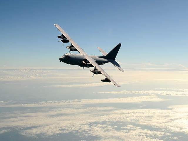 Military cargo airplane in flight at high altitude