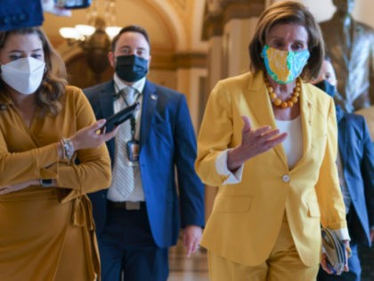 Speaker of the House Nancy Pelosi, D-Calif., leaves the chamber after urging advancement of the John Lewis Voting Rights Advancement Act, named for the late Georgia congressman who made the issue a defining one of his career, at the Capitol in Washington, Tuesday, Aug. 24, 2021. (AP Photo/J. Scott Applewhite)