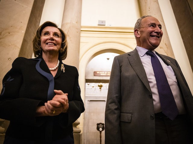 WASHINGTON, DC - JUNE 23: (L-R) U.S. Speaker of the House Nancy Pelosi (D-CA) and U.S. Senate Majority Leader Chuck Schumer (D-NY) talk to reporters after a bipartisan group of Senators and White House officials came to an agreement over the Biden administrations proposed infrastructure plan at the U.S. Capitol …
