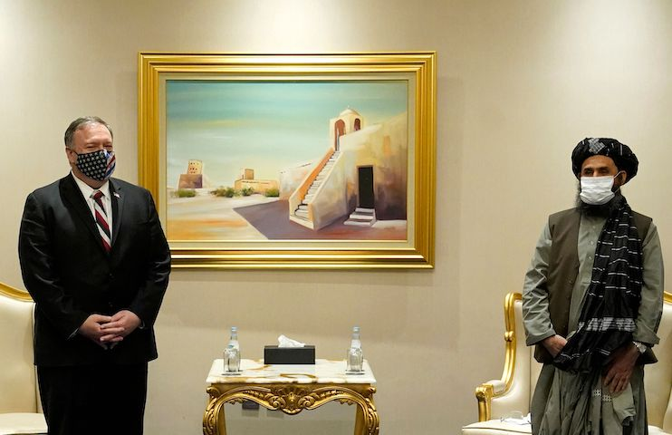 US Secretary of State Mike Pompeo (L) meets with Taliban co-founder Mullah Abdul Ghani Baradar in the Qatari capital Doha, on November 21, 2020. - US Secretary of State Mike Pompeo met negotiators from the Afghan government and the Taliban in Doha, amid signs of progress in their talks as Washington speeds up its withdrawal. Pompeo's visit comes in the wake of a rocket attack which struck densely populated areas of Kabul, killing at least eight people in the latest outbreak of violence in the Afghan capital. (Photo by Patrick Semansky / POOL / AFP) (Photo by PATRICK SEMANSKY/POOL/AFP via Getty Images)
