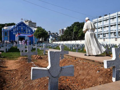 Pope Francis performs a blessing ritual at a graveyard in the Church of the Holy Rosary complex, where the Mother Teresa House is part of, in Dhaka on December 2, 2017. Pope Francis arrived in Bangladesh from Myanmar on November 30 for the second stage of a visit that has …
