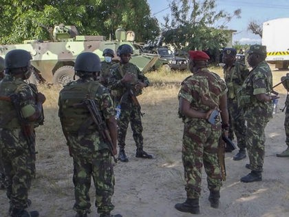 In this image made from video, Rwandan and Mozambican soldiers gather at the airport in Mocimboa da Praia, Cabo Delgado province, Mozambique Monday, Aug. 9, 2021. Fresh from recapturing the strategic northern Mozambican port of Mocimboa da Praia held by Islamic extremist rebels for a year, Rwandan and Mozambican troops …