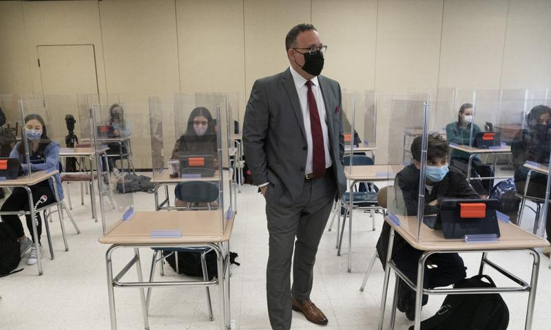 Secretary of Education Miguel Cardona talks to students at White Plains High School, Thursday, April 22, 2021, in White Plains, N.Y. Cardona visited as part of the 'Help is Here' tour. The school reopened to all students on April 12. (AP Photo/Mark Lennihan)