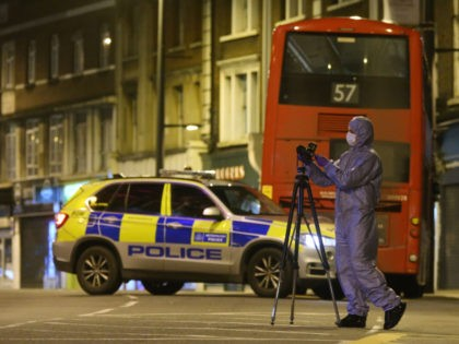 A police forensic officer works on Streatham High Road in south London on February 2, 2020, after a man is shot dead by police following reports of people being stabbed in the street. - British police on Sunday said they had shot a man in south London, after at least …