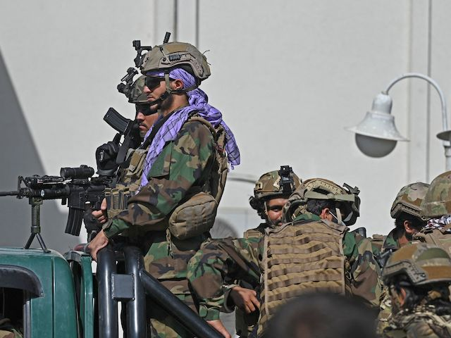 """Taliban Fateh fighters, a """"special forces"""" unit, patrol a street in Kabul on August 29, 2021, as suicide bomb threats hung over the final phase of the US military's airlift operation from Kabul, with President Joe Biden warning another attack was highly likely before the evacuations end. (Photo by Aamir QURESHI / AFP) (Photo by AAMIR QURESHI/AFP via Getty Images)"""