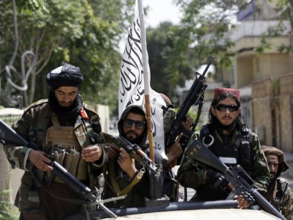 Taliban fighters display their flag on patrol in Kabul, Afghanistan, Thursday, Aug. 19, 2021. The Taliban celebrated Afghanistan's Independence Day on Thursday by declaring they beat the United States, but challenges to their rule ranging from running a country severely short on cash and bureaucrats to potentially facing an armed …