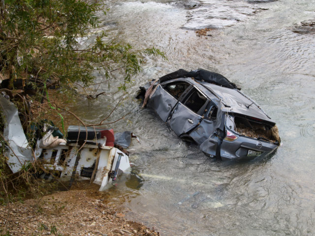 A car and other structure were one of many swept up in a flash flood recently, shown Monday, Aug. 23, 2021, in Waverly, Tenn. Heavy rains caused flooding in Middle Tennessee days ago and have resulted in multiple deaths, and missing people as homes and rural roads were also washed …