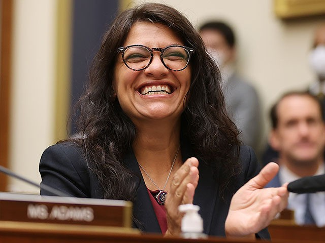 WASHINGTON, DC - JULY 20: House Financial Services Committee member Rep. Rashida Tlaib (D-MI) (R) applauds as Housing and Urban Development Secretary Marcia Fudge is introduced during a committee hearing in the Rayburn House Office Building on Capitol Hill on July 20, 2021 in Washington, DC. Fudge testified about the …