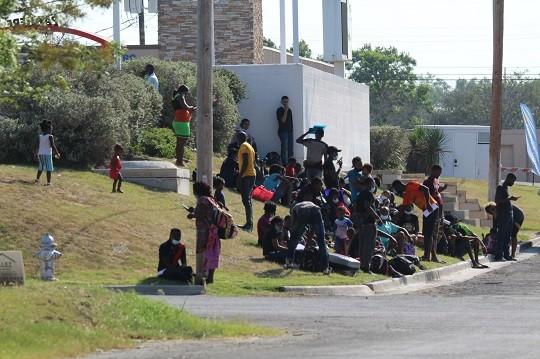 A group of mostly Haitian migrants awaits ground transportation from a non-profit shelter in defiance of a Texas order prohibiting the transport of migrants released by CBP. (Photo: Randy Clark/Breitbart Texas)