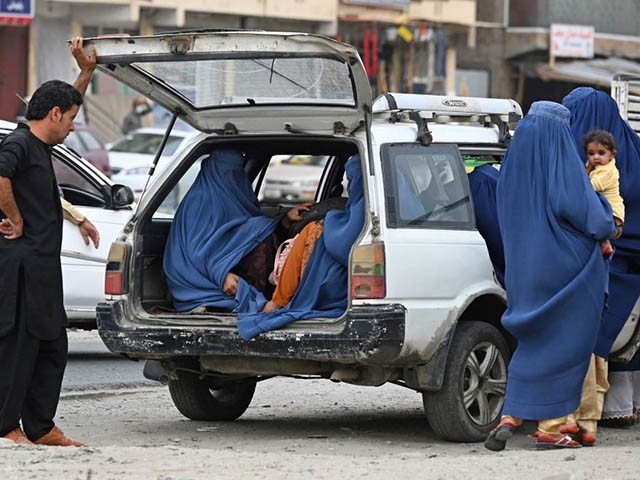 Women wearing a burqa get into a local taxi in Kabul on July 31, 2021. (Photo by SAJJAD HUSSAIN / AFP) (Photo by SAJJAD HUSSAIN/AFP via Getty Images)