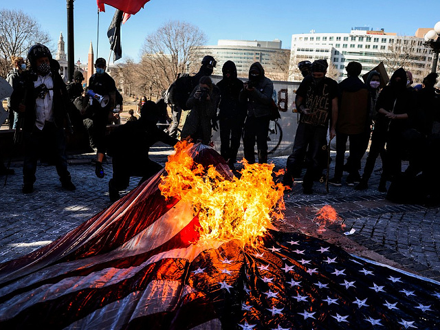 DENVER, CO - JANUARY 20: Members of the Communist Party USA and other anti-fascist groups burn an American flag on the steps of the Colorado State Capitol on January 20, 2021 in Denver, Colorado. Joe Biden was sworn in as the 46th President of the United States with Vice President Kamala Harris at an inauguration ceremony in Washington DC earlier in the day. (Photo by Michael Ciaglo/Getty Images)