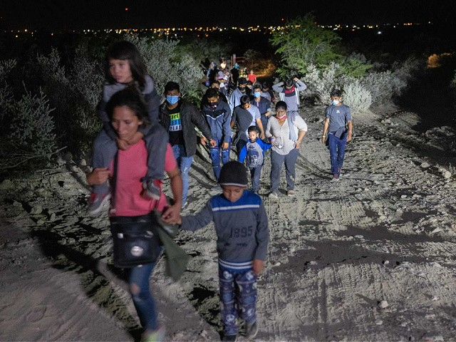 ROMA, TEXAS - AUGUST 14: Immigrants walk towards a U.S. Border Patrol checkpoint after they crossed the Rio Grande from Mexico on August 14, 2021 in Roma, Texas. Recent U.S. Customs and Border Protection figures show more than 200,000 people were apprehended at the border in July, the highest number in 21 years. (Photo by John Moore/Getty Images)