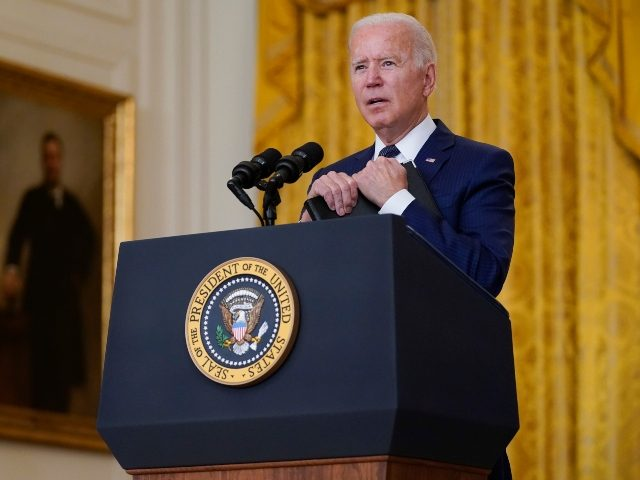 President Joe Biden answers questions from members of the media about the bombings at the Kabul airport that killed at least 12 U.S. service members, from the East Room of the White House, Thursday, Aug. 26, 2021, in Washington. (AP Photo/Evan Vucci)