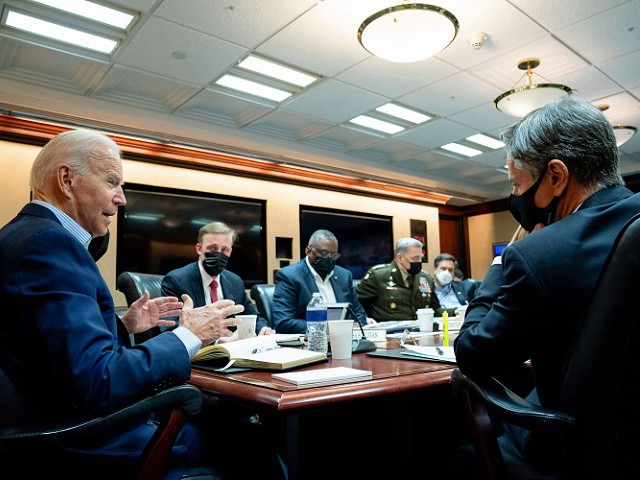 WASHINGTON, DC - AUGUST 22: In this handout photo provided by the White House, President Joe Biden meets with his national security team for an operational update on the situation in Afghanistan on August 22, 2021 at the White House in Washington, DC. They discussed the security situation in Afghanistan and counterterrorism operations, including ISIS-K. Over 7,800 people have been evacuated from Afghanistan over the previous day via U.S. military aircraft, charter flights, and coalition flights, including American citizens and their families, SIV applicants and their families, and other vulnerable Afghans. The national security team discussed the ongoing diplomatic and military efforts to facilitate transit at third-country transit hubs. The President was joined by Secretary of State Antony Blinken (R), Secretary of Defense Lloyd Austin (3rd L), Chairman of the Joint Chiefs of Staff Gen. Mark Milley (4th L), National Security Advisor Jake Sullivan (2nd L), DNI Avril Haines, CIA Director William J. Burns, and other senior officials. (Photo by The White House via Getty Images)