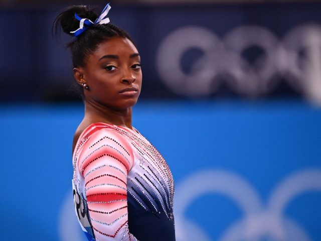 USA's Simone Biles competes in the artistic gymnastics women's balance beam final of the Tokyo 2020 Olympic Games at Ariake Gymnastics Centre in Tokyo on August 3, 2021. (Photo by Loic VENANCE / AFP) (Photo by LOIC VENANCE/AFP via Getty Images)
