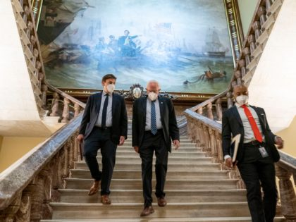 Senate Budget Committee Chairman Bernie Sanders, I-Vt., center, walks towards the Senate floor as the Senate moves from passage of the infrastructure bill to focus on a massive $3.5 trillion budget resolution, a blueprint of President Joe Biden's top domestic policy ambitions, at the Capitol in Washington, Tuesday, Aug. 10, …