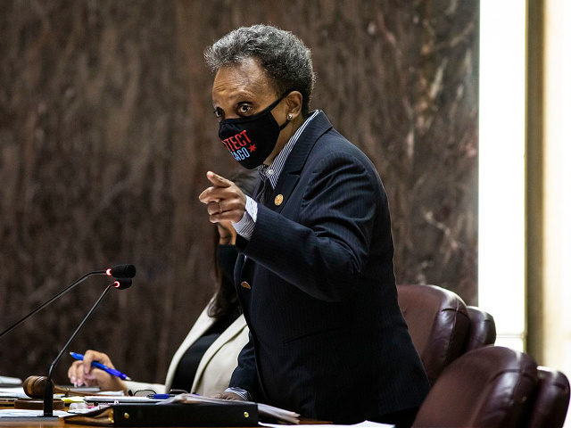 Chicago Mayor Lori Lightfoot presides over the Chicago City Council meeting at City Hall, Wednesday morning, April 21, 2021. Wednesday marked the first in-person council meeting since the start of the coronavirus pandemic more than a year ago. (Ashlee Rezin Garcia/Chicago Sun-Times via AP, Pool)