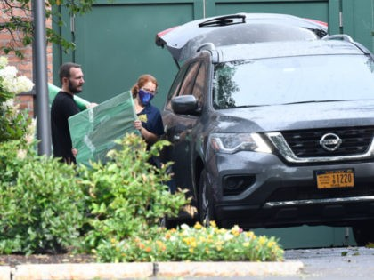 Crews from the Office of General Services load belongings of New York Gov. Andrew Cuomo into vehicles at the New York state Executive Mansion, Friday Aug. 20, 2021, in Albany, N.Y. Lt. Gov. Kathy Hochul will become the first woman to be New York's governor when Cuomo's resignation becomes official …