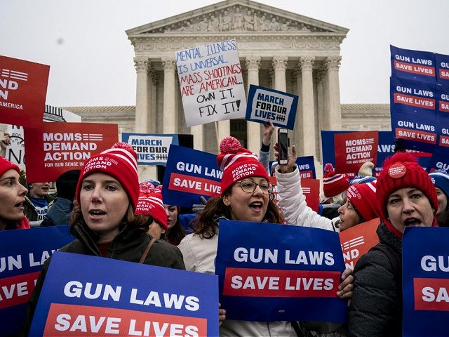 WASHINGTON, DC - DECEMBER 2: Gun safety advocates rally in front of the U.S. Supreme Court before during oral arguments in the Second Amendment case NY State Rifle & Pistol v. City of New York, NY on December 2, 2019 in Washington, DC. Several gun owners and the NRA's New …