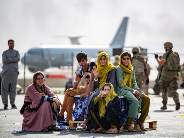 In this image provided by the U.S. Marines, evacuee children wait for the next flight after being manifested at Hamid Karzai International Airport, in Kabul, Afghanistan, Thursday, Aug. 19, 2021. (1st Lt. Mark Andries/U.S. Marine Corps via AP)