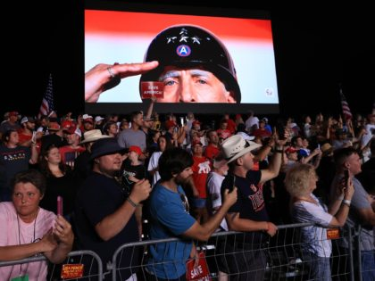 """CULLMAN, ALABAMA - AUGUST 21: A scene from the movie """"Patton"""" is played just before former U.S. President Donald Trump takes the stage during a """"Save America"""" rally at York Family Farms on August 21, 2021 in Cullman, Alabama. With the number of coronavirus cases rising rapidly and no more …"""