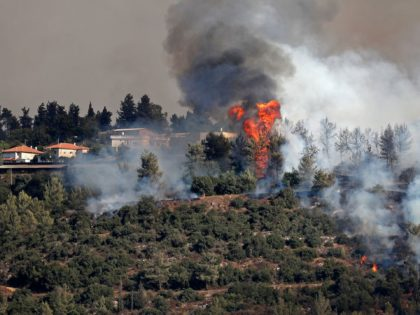 Smoke billows from a forest fire at the Jerusalem mountains near the Israeli village of Moshav Shoresh, on August 16, 2021. (Photo by Ahmad GHARABLI / AFP) (Photo by AHMAD GHARABLI/AFP via Getty Images)