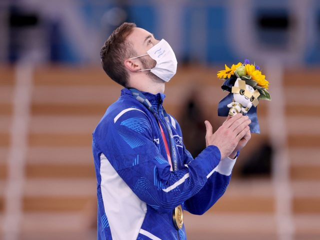 TOKYO, JAPAN - AUGUST 01: Gold medalist Artem Dolgopyat of Team Israel reacts on the podium during the Men's Floor Exercise Victory Ceremony on day nine of the Tokyo 2020 Olympic Games at Ariake Gymnastics Centre on August 01, 2021 in Tokyo, Japan. (Photo by Laurence Griffiths/Getty Images)