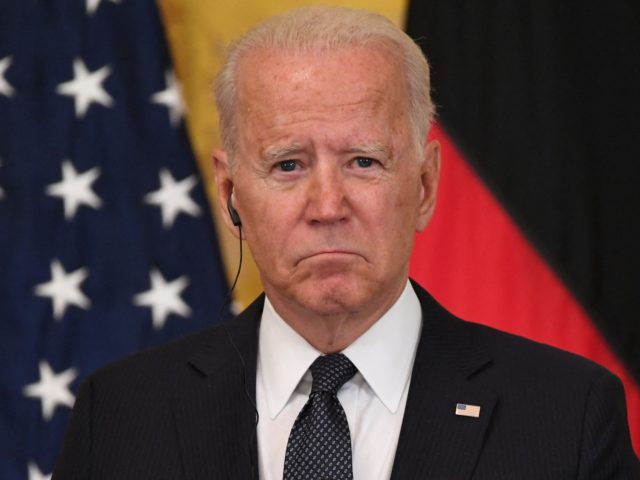 US President Joe Biden listens to German Chancellor Angela Merkel (off frame) during a joint press conference in the East Room of the White House in Washington, DC, July 15, 2021. - Chancellor Angela Merkel on Thursday visited the White House in her diplomatic swan song, a trip underlining how …