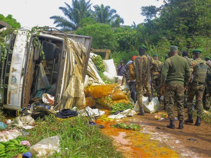 Congolese Defense Forces soldiers inspect the scene of an attack near the town of Oicha, 30 kms (20 miles) from Beni, Democratic Republic of Congo, Friday July 23, 2021. Congo's military says at least 16 people were killed and eight injured after an attack by suspected Allied Democratic Forces rebels …
