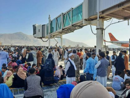 OPSHOT - Afghans crowd at the tarmac of the Kabul airport on August 16, 2021, to flee the country as the Taliban were in control of Afghanistan after President Ashraf Ghani fled the country and conceded the insurgents had won the 20-year war. (Photo by - / AFP) (Photo by …