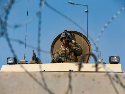 In this Aug. 21, 2021, photo provided by the U.S. Marine Corps, a U.S. Marine assigned to 24th Marine Expeditionary Unit (MEU) provides over-watch during an evacuation at Hamid Karzai International Airport in Kabul, Afghanistan. (Lance Cpl. Nicholas Guevara/U.S. Marine Corps via AP)