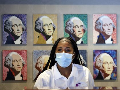 WASHINGTON, DC - JULY 30: A hotel employee wears a mask inside a lobby on July 30, 2021 in Washington, DC. DC Mayor Muriel Bowser restored a COVID-19 indoor mask mandate, regardless of vaccination status, starting Saturday. (Photo by Kevin Dietsch/Getty Images)