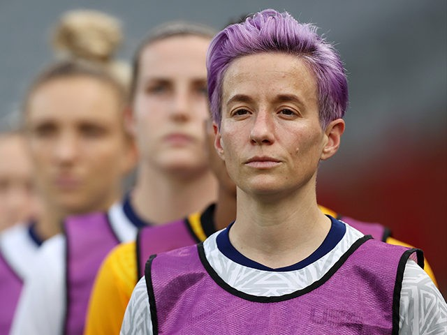 CHOFU, JAPAN - JULY 21: Megan Rapinoe #15 of Team United States reacts as she warms up prior to the Women's First Round Group G match between Sweden and United States during the Tokyo 2020 Olympic Games at Tokyo Stadium on July 21, 2021 in Chofu, Tokyo, Japan. (Photo by …