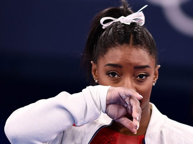 TOPSHOT - USA's Simone Biles gestures during the artistic gymnastics women's team final during the Tokyo 2020 Olympic Games at the Ariake Gymnastics Centre in Tokyo on July 27, 2021. (Photo by Loic VENANCE / AFP) (Photo by LOIC VENANCE/AFP via Getty Images)