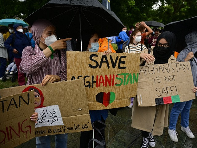 Protesters display placards as they demonstrate to support the Afghan people on August 22, 2021 in front of the Chancellery in Berlin. (Photo by John MACDOUGALL / AFP) (Photo by JOHN MACDOUGALL/AFP via Getty Images)