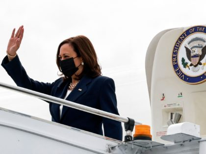 US Vice President Kamala Harris waves upon arrival at Paya Lebar Base airport in Singapore, August 22, 2021. (Photo by EVELYN HOCKSTEIN / POOL / AFP) (Photo by EVELYN HOCKSTEIN/POOL/AFP via Getty Images)